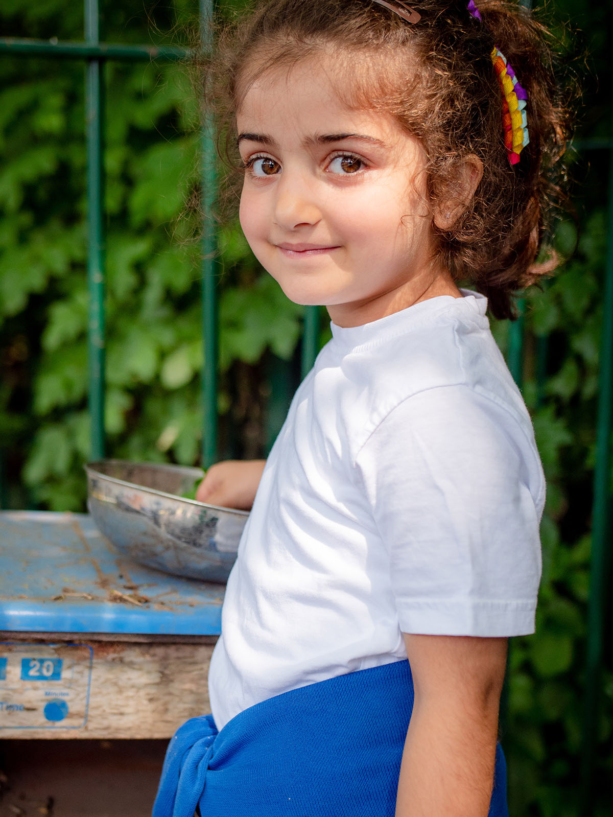Young girl smiling whilst playing in playground